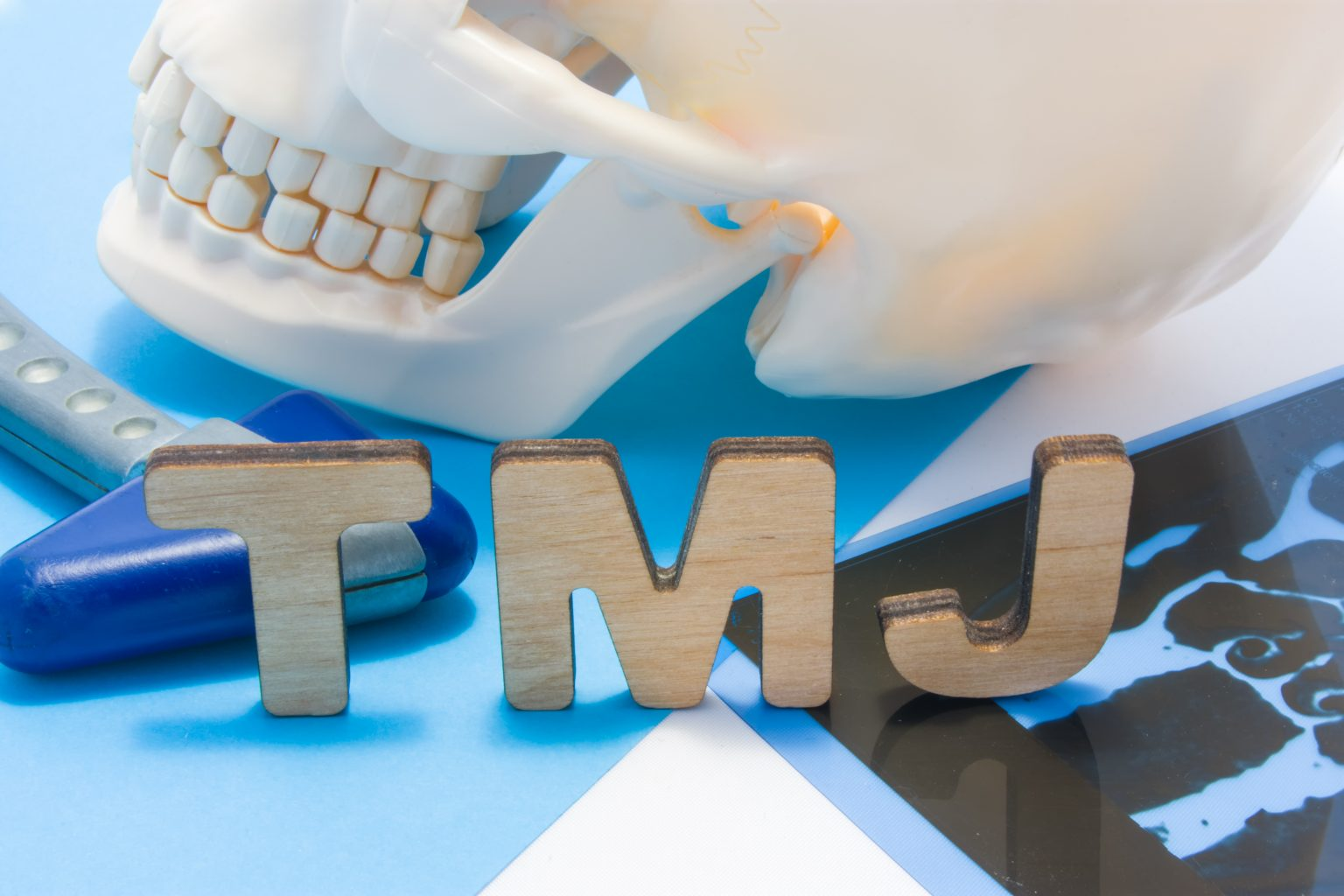 Tmj Medical Abbreviation Of Temporomandibular Joint. Tmj Letters Surrounded By Human Skull With Lower Jaw, Neurological Hammer And Radiographs. Concept Of Anatomy, Pathology Of Temporomandibular Joint